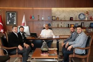 ÜMİMDER'den Başkan Hasan Can'a Ziyaret