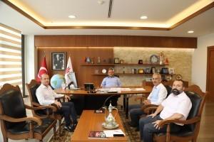 Yeni İlçe Gençlik ve Spor Müdürü Baturalp Eliçevik Başkan Hasan Can'a Ziyarette Bulundu